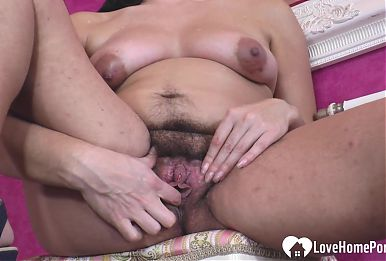 Hairy busty babe explores her love tunnel